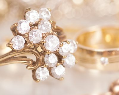 Gold jewelry with diamonds with reflection.